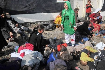 In the deadliest incident, a suspected suicide bomb struck a shrine packed with worshippers in the capital, Kabul, killing at least 54.  Photo by Massoud Hussaini