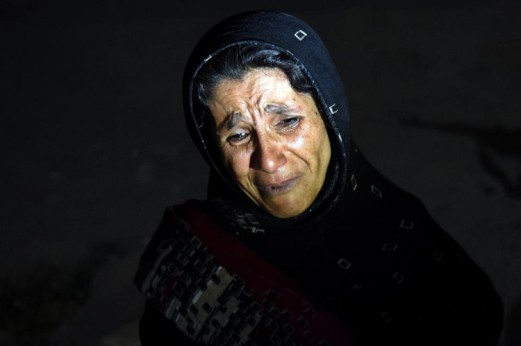 An Afghan woman cries as she looks for her son after a suicide attack at the entrance to the Police Academy in Kabul killed more than 20 cadets. (Photo: Wakil Kohsar/AFP)