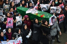 A protest convoy drove the bodies of seven members of Afghanistan's minority Hazara community to the capital Kabul on Tuesday to protest against their murder by unknown militants, who dumped their partially beheaded bodies at the weekend.