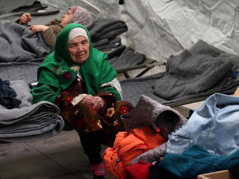 Bibihal Uzbeki, 105, from Kunduz, Afghanistan, rests in Croatia's main refugee camp at Opatovac, Croatia, near the border with Serbia AP